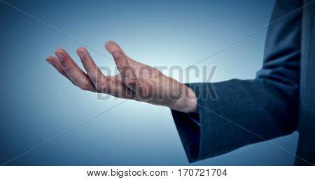 Cropped image of businessman offering against purple vignette