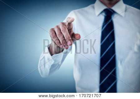 Midsection of man pointing against purple vignette