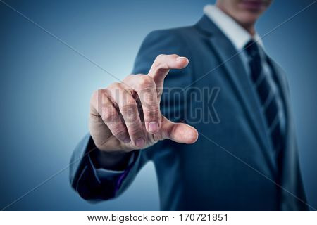 Midsection of sophisticated businessman indicating against purple vignette
