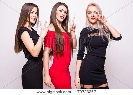 Three Fashion Models In  Night Dresses.