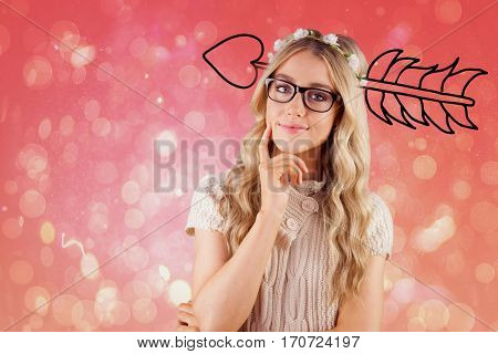Gorgeous smiling woman thinking against red abstract light spot design