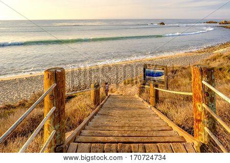 USA Pacific coast landscape, boardwalk to Leo Carrillo State Beach, Malibu, California.