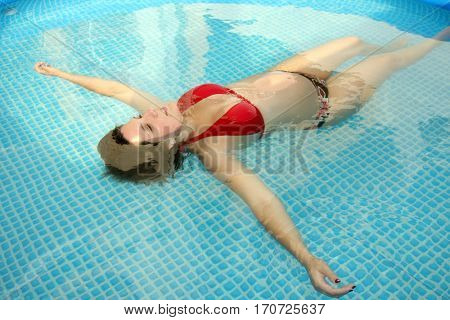 Beautiful pregnant woman happy smiling in swimming pool