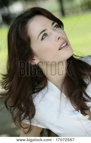 outdoor portrait of a expressive caucasian beautiful charming woman