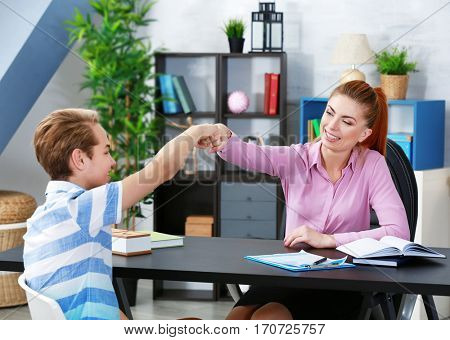 Teenager having therapy session with therapist at office