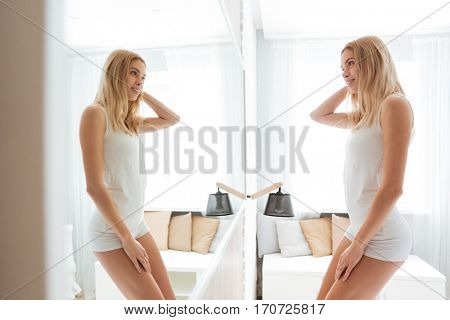 Side view of Woman with her reflection in the mirror