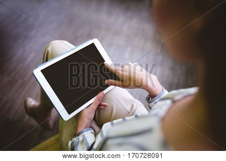 High angle view of young businesswoman using tablet at office