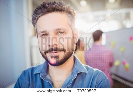 Portrait of confident young male executive at creative office