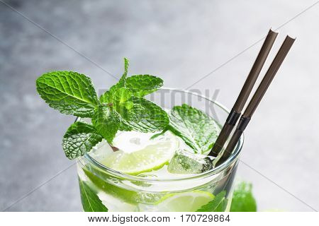 Mojito cocktail on dark stone table