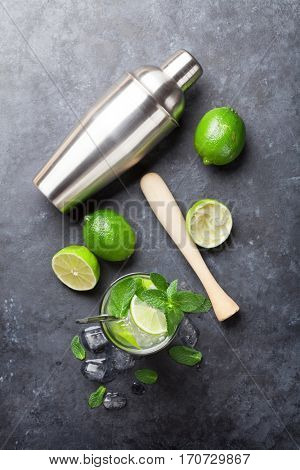 Mojito cocktail on dark stone table. Top view
