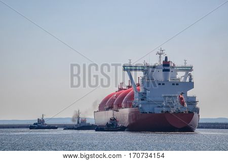GAS CARRIER - Ship during a maneuver berth to the gas terminal