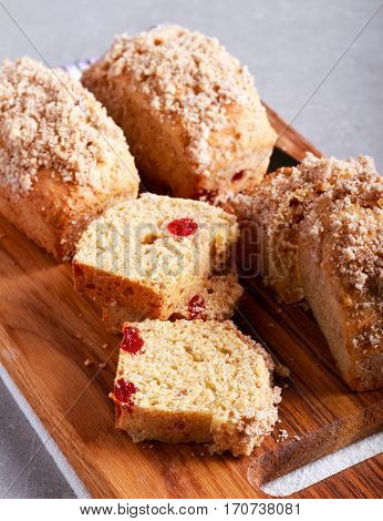 Cherry mini loaves with streusel sliced on board