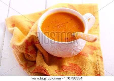 Carrot and orange soup with nutmeg in a cup