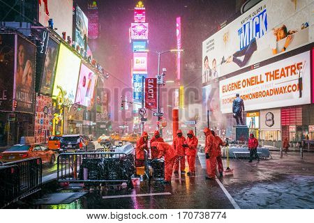 NEW YORK-FEBRUARY 9 - Workers in orange rain gear get ready for snow clean up in Times Square on February 9 2017 in New York City.
