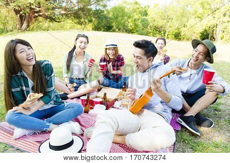 happy young friends group enjoying picnic party