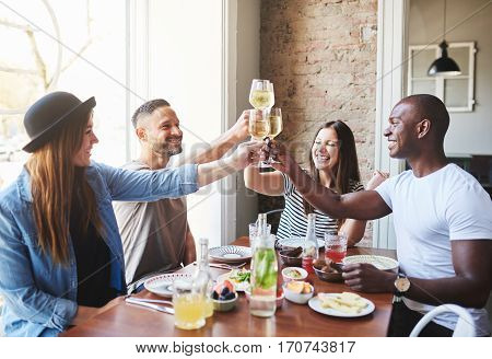 Group Of Friends Having Dinner And Clinking