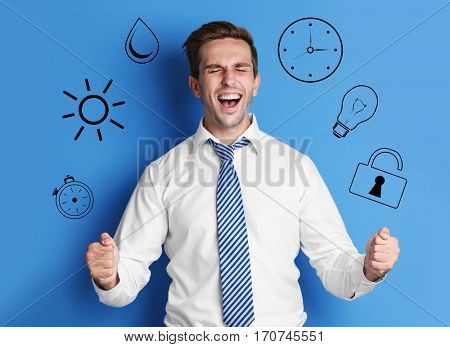 Business and time management concept. Young man on blue background