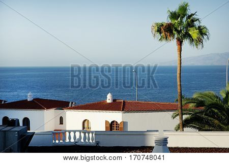 Typical houses near coastline - street view of small touristic town in Spain. Tenerife, Canary islands.