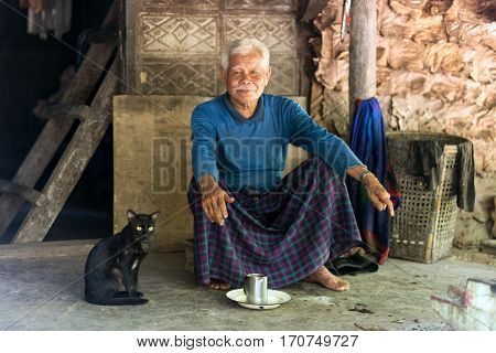 HPA-AN, MYANMAR - JANUARY 22, 2017 : A Karen tribe elderly man, 85 years old, is living alone in the forest in Hpa-An, Myanmar