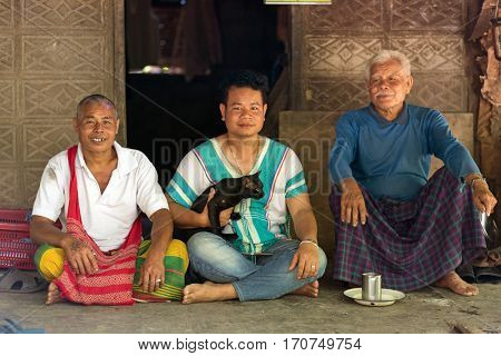 HPA-AN, MYANMAR - JANUARY 22, 2017 : Karen tribe family portrait, father 85 years old and his two sons in Hpa-An, Myanmar
