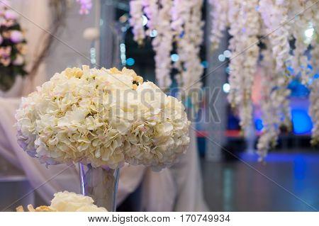 beautiful wedding bouquet on wedding table in restaurant.