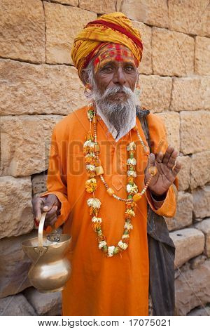 jain priest welcoming saluting in jaisalmer in rajasthan state in india