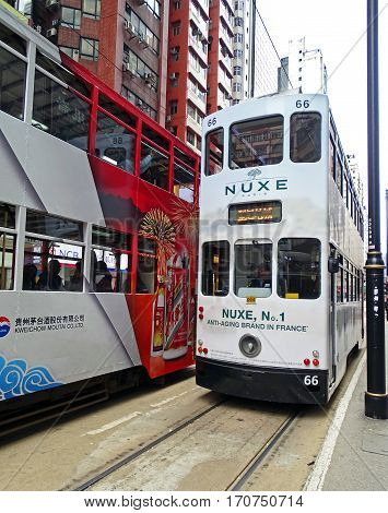North Point, Hong Kong - February 10, 2016: Two old double-decker trams encounter while driving through North Point, Hong Kong.