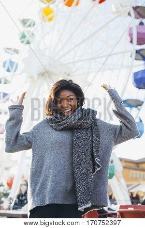 Fashion blogger having fun in an amusement park