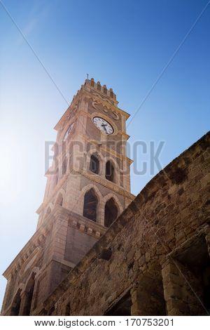 Khan al-Umdan Clock Tower in Old City Acre Israel. Symbols of Islam ancient building