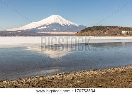 Reflection of Winter Mount Fuji at Iced Yamanaka Lake in snow winter season Japan