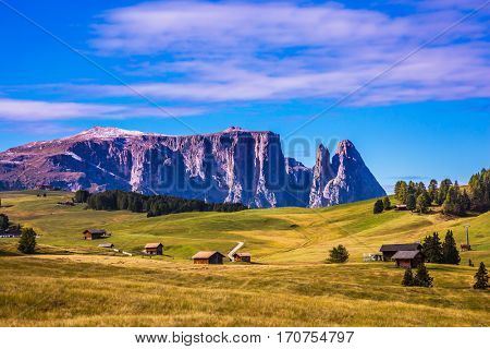 Jagged rocks around the Dolomites mountain valley. Well-known international ski resort in the fall. The Alps di Siusi. Concept of active and ecological tourism
