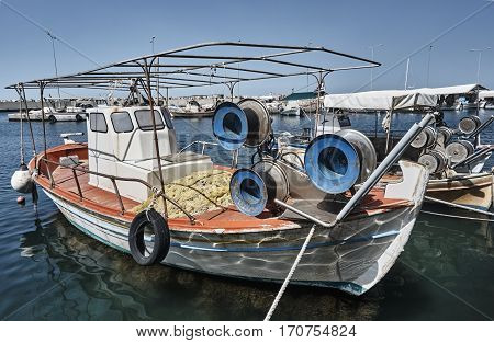 Fishing boats in the harbor on the coast of the Aegean Sea in Greece