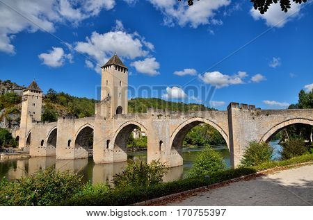 Pont Valentre, fortified stone arch bridge crossing the Lot River at Cahors, France.