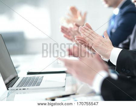 Male hands applauding after presentation of project at conferenc