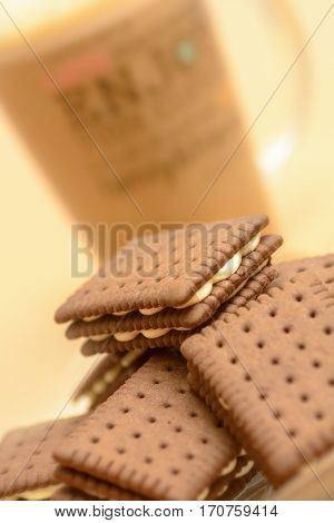Cocoa biscuits filled with vanilla cream and coffe. Shallow DOF