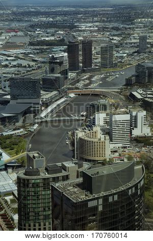Aerial view of buildings and footbridge in Downtown Melbourne over the Yarra river in Australia