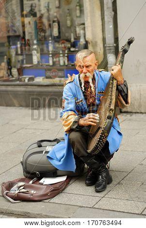 KRAKOW, POLAND - JUNE 13: Unknown Ukrainian gusla player on June 13, 2007 in Krakow.