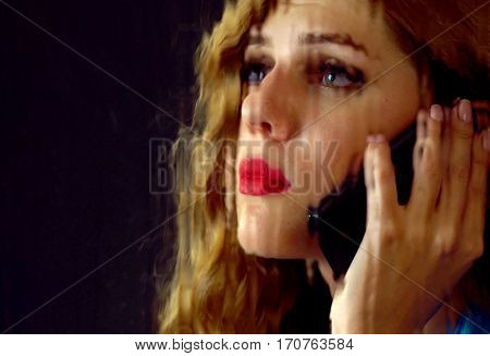 Woman crying by phone. Girl talking on phone . Portrait of sad female behind window with rain. Black background.