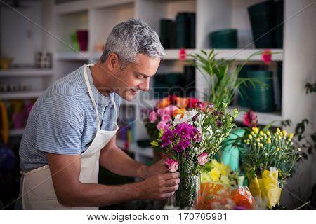 Florist preparing a flower bouquet in flower shop