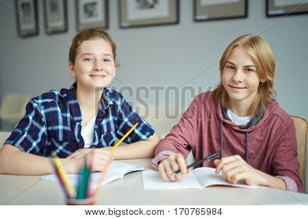 Young scholars sitting at lesson in college