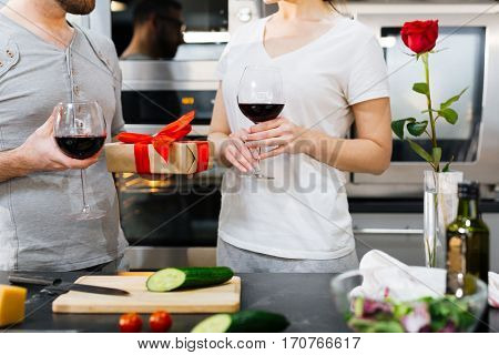 Amorous couple celebrating Valentine day at home in the kitchen