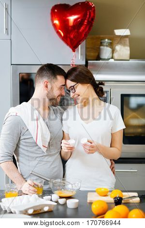 Flirty couple celebrating Valentine day at home