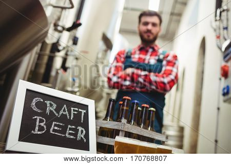 Low angle view of craft beer sign with manufacturer in brewery