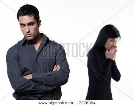 young couple on white background having a dispute