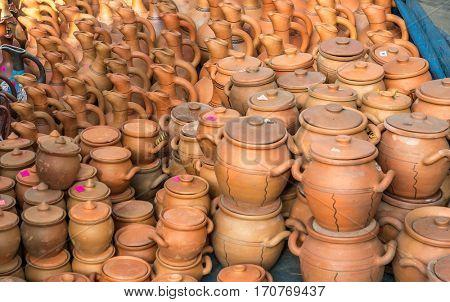 National pretty pottery on Georgian street bazaar in summer day