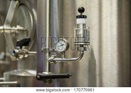 Close-up of barometer at brewery factory
