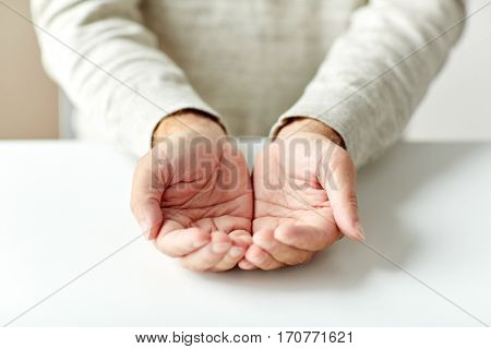 charity, donation, poverty and people concept - close up of empty senior man hands