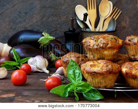 Snack Savory Muffins Cakes With Eggplant, Tomatoes, Basil And Cheese On Wooden Background. Selective