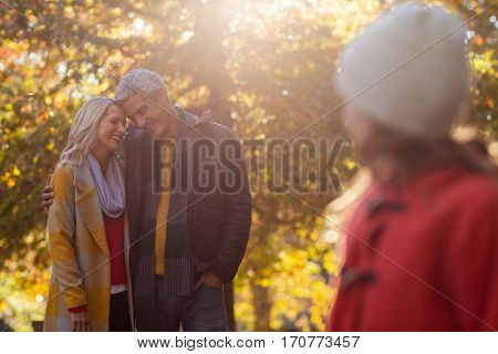 Girl looking towards couple romancing at park