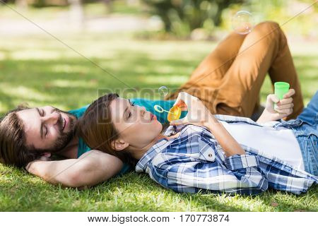 Couple relaxing together in park